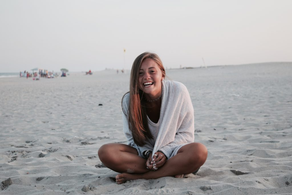 girl laughing on beach